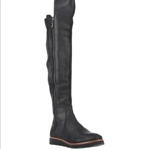 Women's over-the-knee black leather boots.